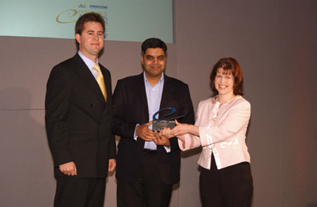 Taxcafe founder Nick Braun and Aileen Smith receive the award from Ajaz Ahmed, founder of Freeserve.